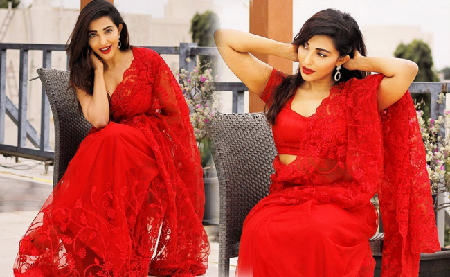 Parvati Nair is pretty Looks in a red saree