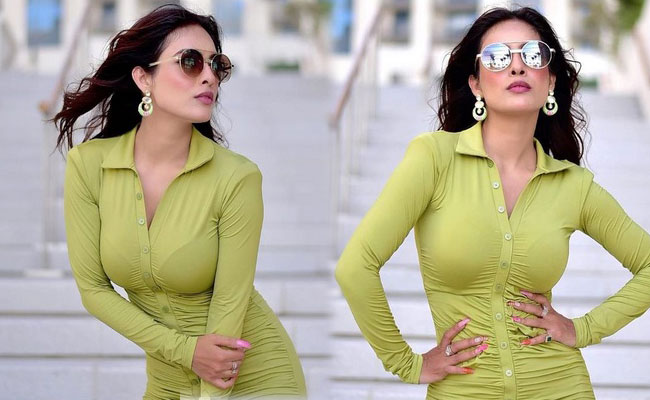 Neha Malik Hot Photoshoot in Green Outfit